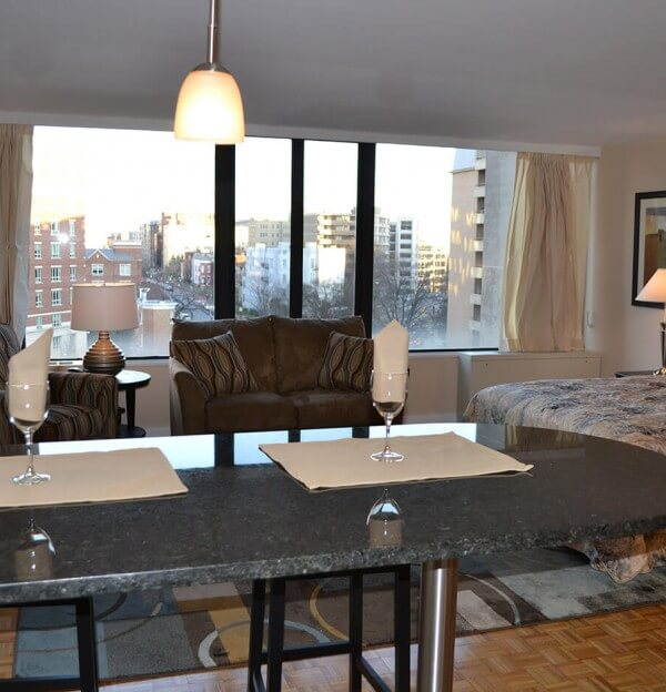 Studio apartment dining area with wood floors